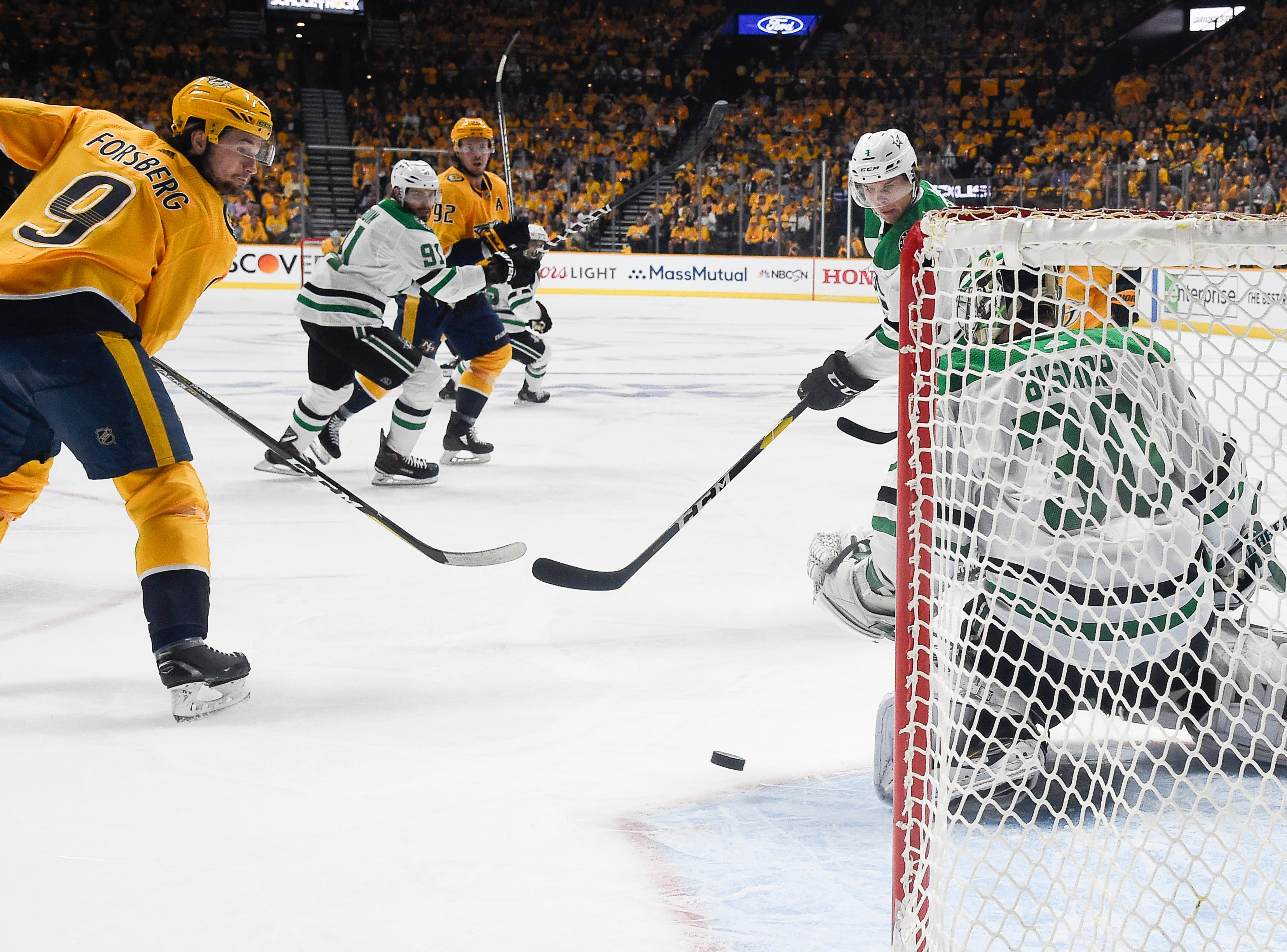 Nashville Predators left wing Filip Forsberg (9) tries to get the puck past Dallas Stars goaltender Ben Bishop (30) during the first period of the divisional semifinal game at Bridgestone Arena Wednesday, April 10, 2019 in Nashville, Tenn.