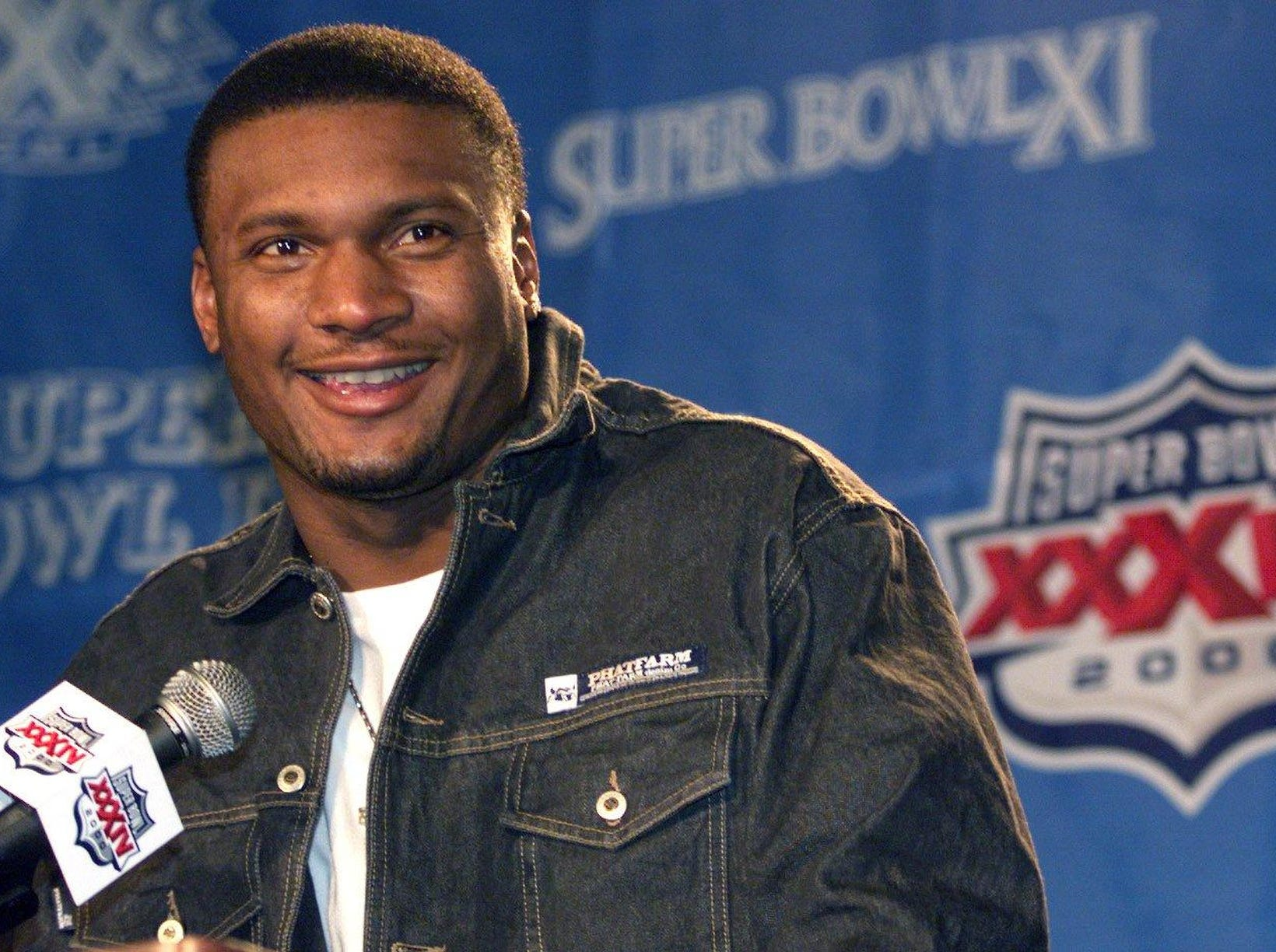 Tennessee Titans quarterback Steve McNair smiles as he answers questions from journalists during a press conference outside their hotel in a tent Jan. 26, 2000. Temperature was in the 20's during the press conference in Atlanta for Super Bowl XXXIV.
