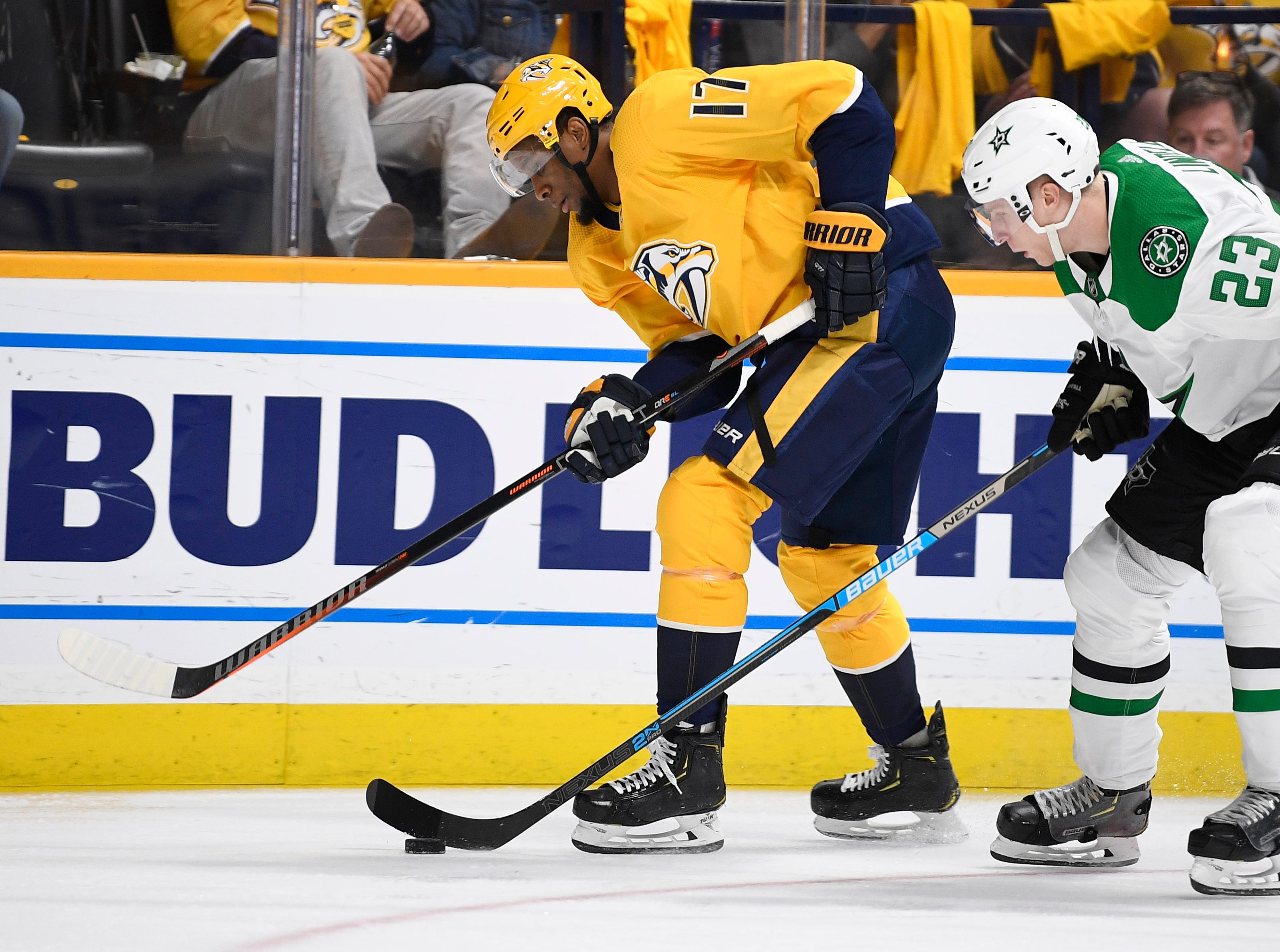 Nashville Predators right wing Wayne Simmonds (17) and Dallas Stars defenseman Esa Lindell (23) battle for the puck during the first period of the divisional semifinal game at Bridgestone Arena in Nashville, Tenn., Wednesday, April 10, 2019.