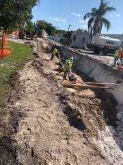 A construction crew works on installing a sanitary sewer system on Cooper Drive in Naples earlier this year. The Naples City Council voted in October to convert all homes in the city's utilities service district from septic tanks to city sewer.