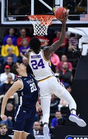 LSU Tigers forward Emmitt Williams (24) drives against Yale Bulldogs forward Paul Atkinson (20) during the second half in the first round of the 2019 NCAA Tournament at Jacksonville Veterans Memorial Arena. Williams, a Fort Myers native, declared for the NBA Draft on Thursday,