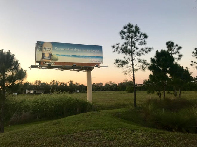 A billboard on the property in Estero where developers have plans to build an Aldi grocery store.