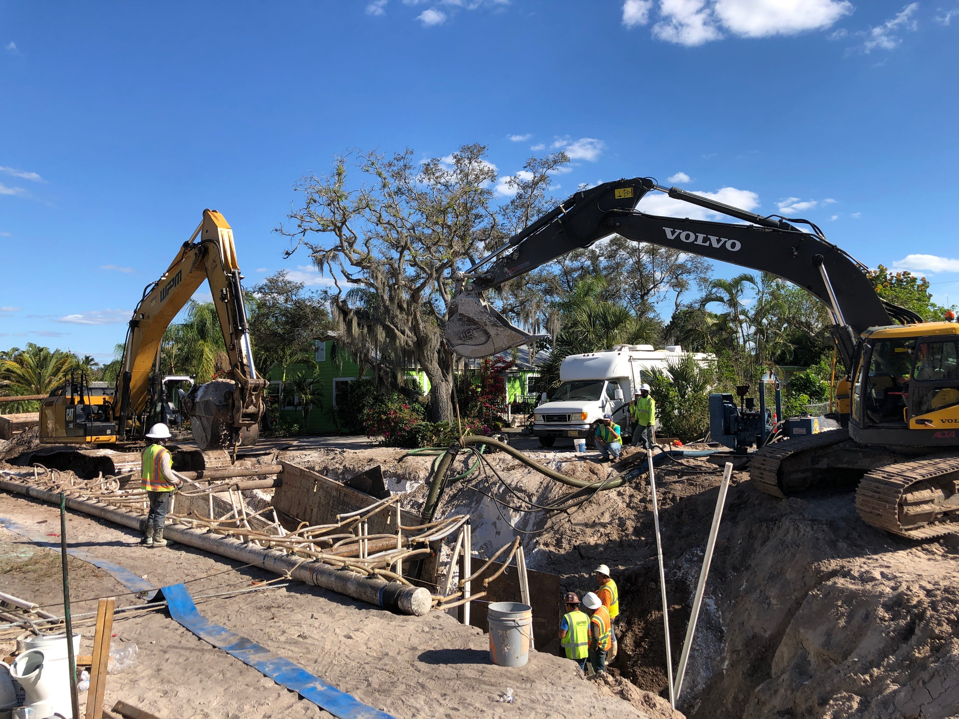 A construction crew works on installing a sanitary sewer system on Ridge Street in Naples earlier this year. The Naples City Council voted in October to convert all homes in the city's utilities service district from septic tanks to city sewer.
