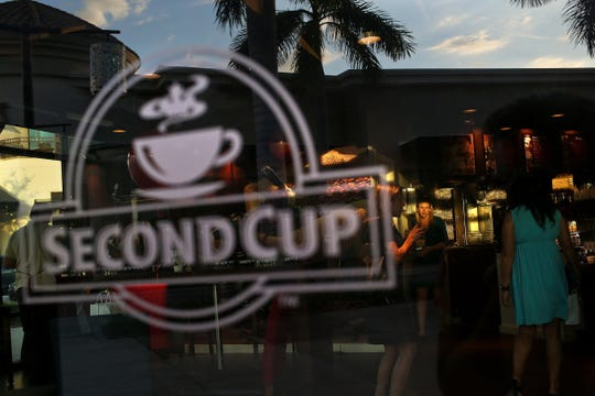 Second Cup in Mercato celebrates its opening on Nov. 21, 2013. After more than a five-year run in North Naples, the coffee shop is permanently closing Sunday, April 14, 2019.