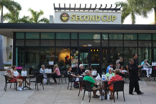 Second Cup celebrates its opening in Mercato on Nov. 21, 2013. After more than a five-year run in North Naples, the coffee shop is permanently closing Sunday, April 14, 2019.