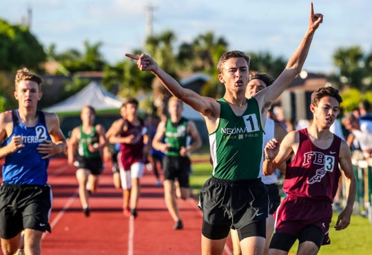 Andrew Mitchell, St. John Neumann, celebrates his win in the boys 800. Action from the finals as track and field teams from Collier and Lee county schools compete in the Class 1A-District 8 meet.