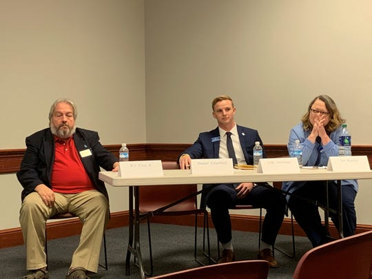 Newark City Council candidates Bill Cost Jr., Seth Dobbelaer, and Jen Kanagy listen to a municipal court judge candidate during a League of Women Voters of Licking County Meet the Candidates Night on Thursday, April 10, 2019. Candidate Dan Crawford was late to the event due to a death in the family.