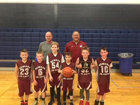 This Newark Junior Cats fourth grade team won the Ohio Youth Basketball championship.