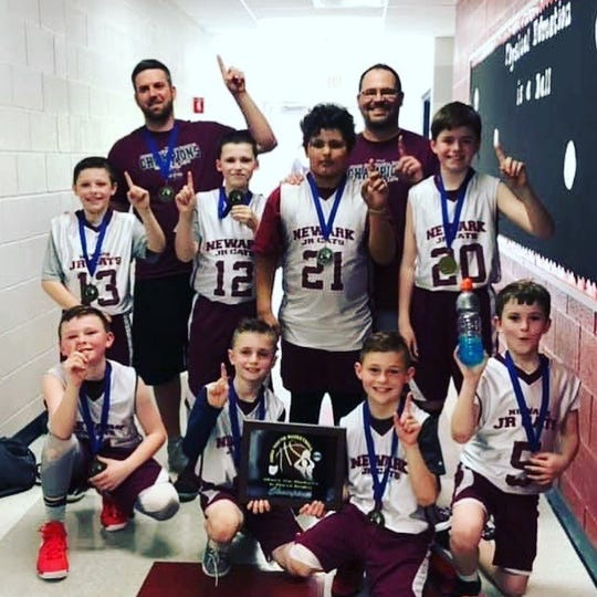 This Newark Junior Cats third grade team won the Ohio Youth Basketball championship.