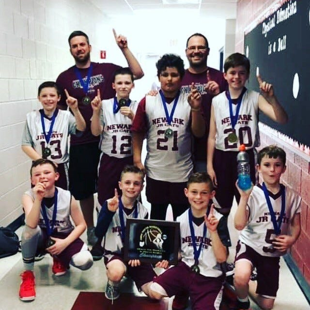 This Newark Junior Cats third grade team won the Ohio Youth Basketball championship.