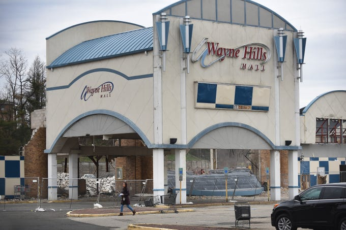A shopper is seen as the Wayne Hills Mall is being demolished, photographed in Wayne on April 11, 2019.