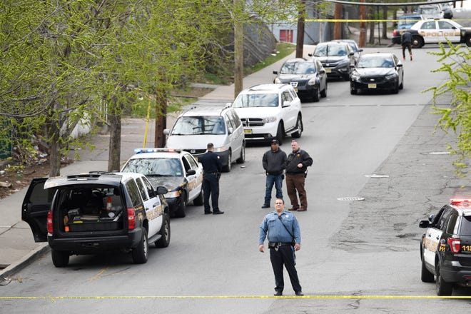 Police on the scene of a shooting on Temple Street in Paterson on Thursday, April 11, 2019.