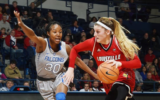 Sam Fuehring drives the ball for Louisville.