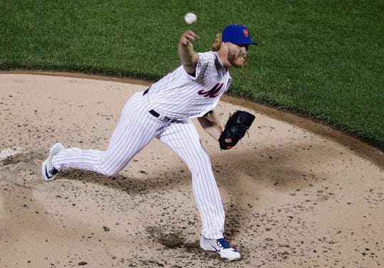 New York Mets' Noah Syndergaard delivers a pitch during the fifth inning of the team's baseball game against the Minnesota Twins on Wednesday, April 10, 2019, in New York. (AP Photo/Frank Franklin II)