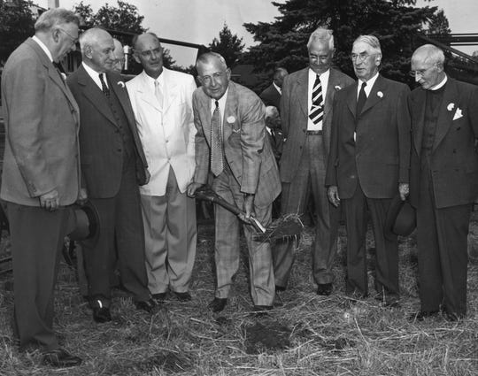 J. Robert Stout, president of the Ridgewood Hospital Association, is shown turning over the first spadeful of earth yesterday afternoon at the official ground-breaking ceremonies for the Valley Hospital, designed to serve the entire West Bergen area, on September 19, 1949. Also shown in the photo, left to right, are: Richard D. Fine, architect, and John J. Newberry, J. Gilbert Mearns, David S. Beasley, Dr. John B. Hopper, and the Rev. Edwin S. Carson. The last three men, members of the original board of directors of the Association, are still serving after 23 years.
