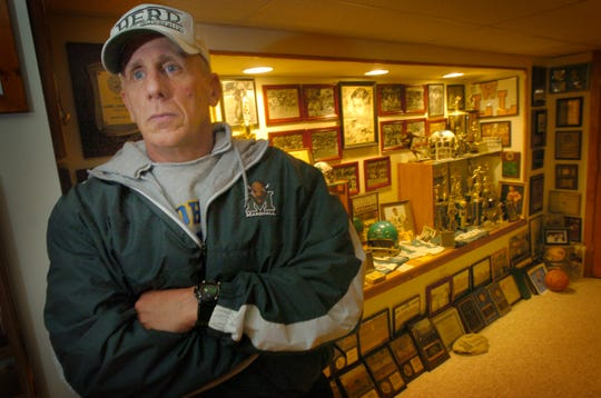 Tom Shoebridge of Lyndhurst on Dec. 18, 2006, brother of Ted Shoebridge, quarterback of the Marshall University football team killed in a plane crash in 1970, has built a memorial trophy case to his brother in his home.  The center section is dedicated to Ted.  Tom and another brother's trophies are in the case as well.