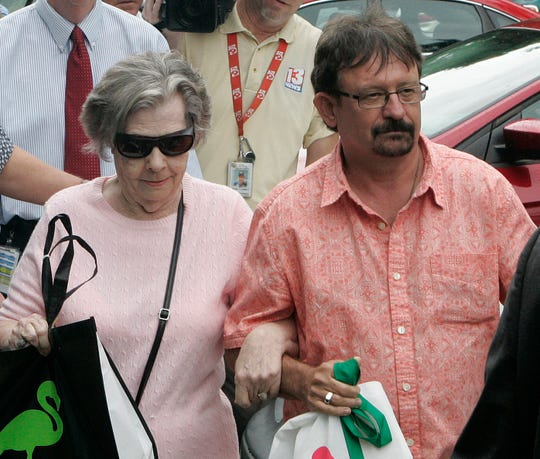 In this June 5, 2013 file photo, Powerball winner Gloria Mackenzie, left, leaves the lottery office escorted by her son, Scott Mackenzie, after claiming a single lump-sum payment of about $370.9 million before taxes in Tallahassee, Fla.