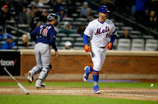 New York Mets first baseman Pete Alonso (20) goes to first base after a walk in the fifth inning against the Minnesota Twins  at Citi Field.
