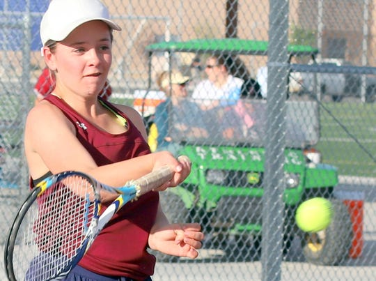 Senior Lady 'Cat Kelcy Sigman used a strong return-of-serve to post her singles victory in Deming's 7-2 dual victory Tuesday over the Gadsden High Panthers.