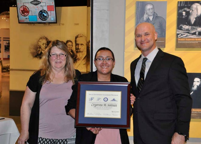 Crystina Holman, an area graduate and Human Resources Administrator for Doña Ana County, stands with Local Government Leadership Program Committee Chair, Brian Dunlap, LGLP 2016, Core 2018, and Committee Member Tracy O'Neal, LGLP 2015, Deputy Human Resource Officer, New Mexico National Guard.