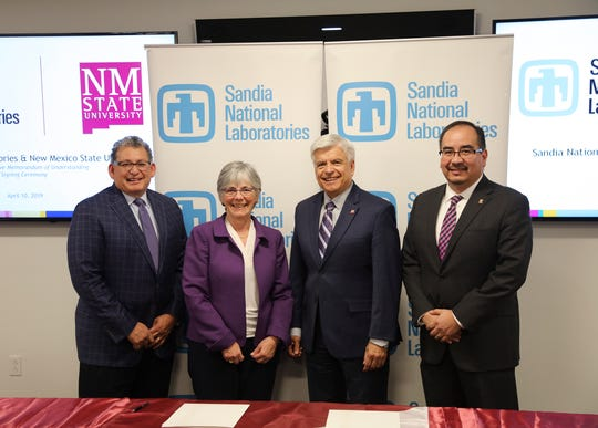 New Mexico State University and Sandia National Laboratories signed a 10-year memorandum of understanding April 10 in Albuquerque. From left, Jaime Moya, director of environment, safety and health, Sandia National Laboratories; Susan Seestrom, associate labs director and chief research officer, Sandia National Laboratories; Dan Arvizu, NMSU chancellor; and Dan Sanchez, technology partnerships program manager, National Nuclear Security Administration Sandia Field Office; attend the signing ceremony.