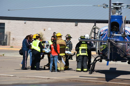 An emergency services helicopter takes a student volunteer after she was removed from the staged crash site in front of the Chaparral High School on Thursday, April 11, 2019.