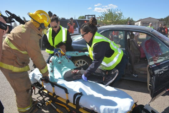 """First responders attend to a student volunteer who was """"injured"""" in a staged crash at Chaparral High School on Thursday, April 11, 2019."""