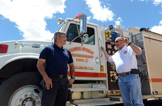 Radium Springs fire chief Louis Bencomo, left, speaks to volunteer firefighter Rick Richardson on Thursday, April 11, 2019.