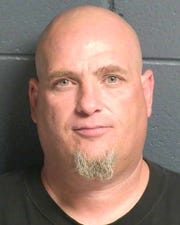 """Kenneth Harper, 44, is accused of using a fraudulent check to """"purchase"""" a vehicle."""