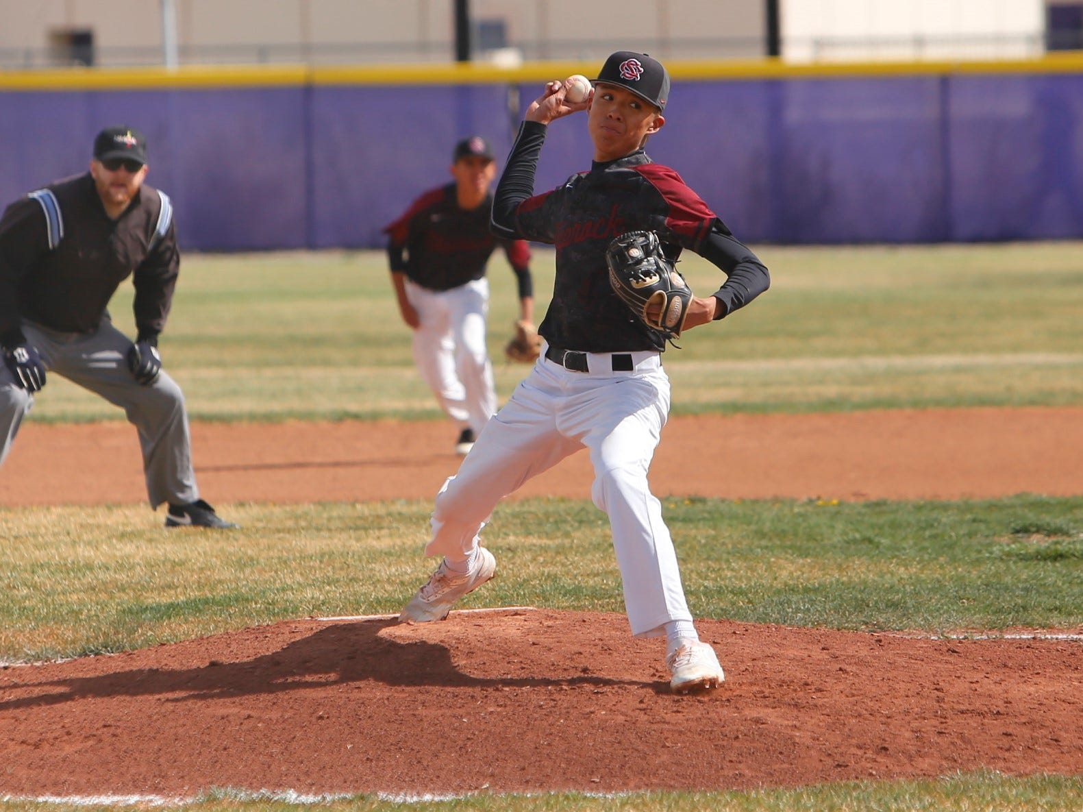 Shiprock's Kobe Allen fires a pitch against Kirtland Central during Thursday's District 1-4A game at KCHS.