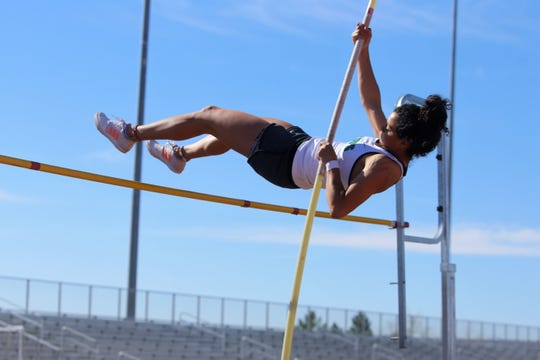Farmington's Kiara Quezada catapults over the bar in the girls pole vault during the FHS Invitational on Saturday, March 30 at Hutchison Stadium. Quezada qualified for state in both the 5A girls pole vault and 300-meter hurdle events.