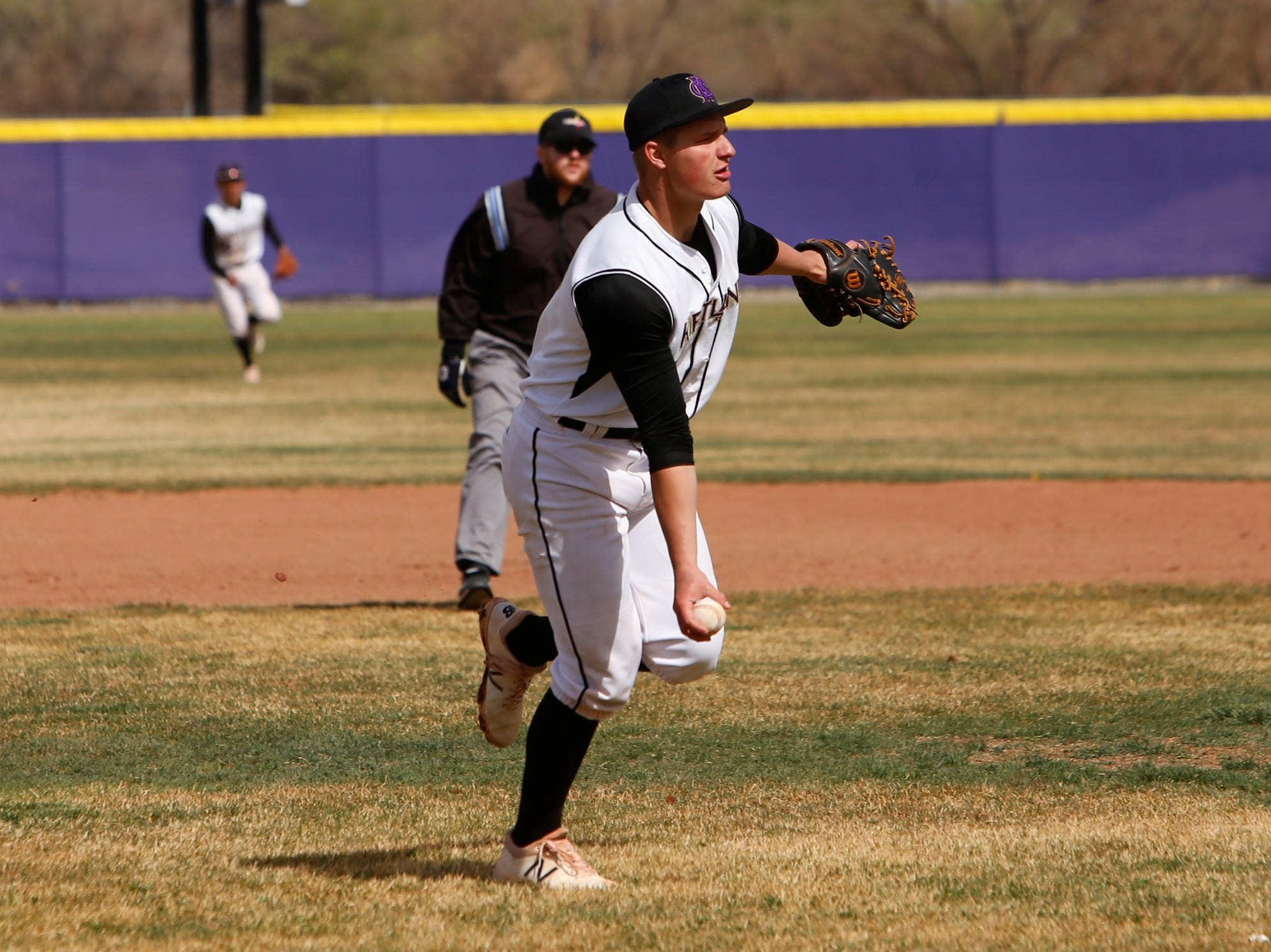 Kirtland Central's Cadan Flack tosses the ball to first base for an easy out against Shiprock during Thursday's District 1-4A game at KCHS.