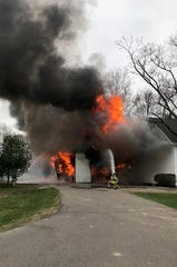 Flames shot from a barn fire Wednesday, April 10, 2019, at Manresa Jesuit Retreat House in Bloomfield Hills.