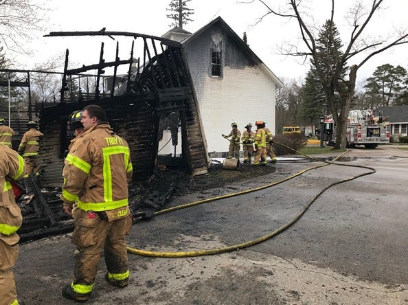 Flames damaged a barn Wednesday, April 10, 2019, at Manresa Jesuit Retreat House in Bloomfield Hills.