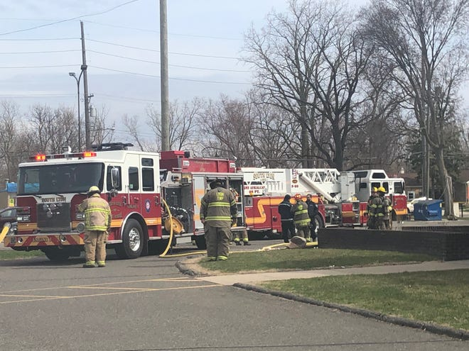 South Lyon, Lyon Township and Green Oak firefighters responded to a downed wire at PNC Bank in South Lyon Thursday, April 11, 2019.