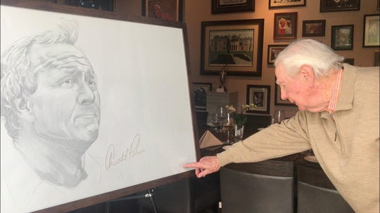 Charlie Mechem examines a portrait of his long-time friend and business associate Arnold Palmer. The portrait, by artist James David Chase, will be displayed in the Palmer Room of Arnold Palmer's Restaurant in La Quinta.