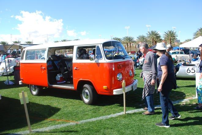 A classic orange Volkswagen bus.