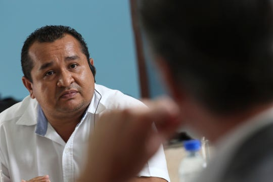 Oscar Benavides, director of the San Francisco Gotera prison in Morazán, tells California Gov. Gavin Newsom about the 1500 gang members who renounced their criminal structures to accept the gospel of Jesus Christ during a work meeting at the Divine Providence Hospital in San Salvador, El Salvador, Tuesday, April 9, 2019. (AP Photo/Salvador Melendez)