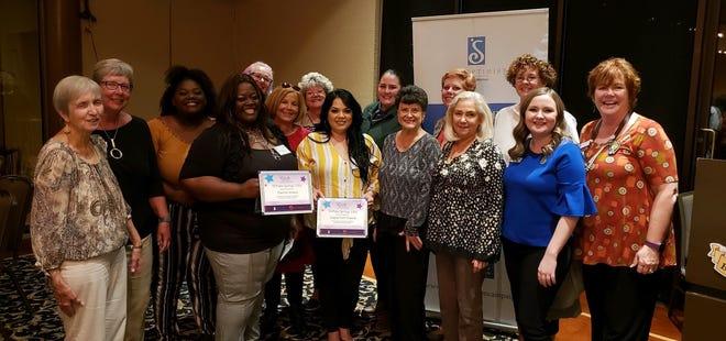 Soroptimist International of Palm Springs Club members with the winners.