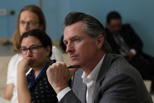 California Gov. Gavin Newsom listens to rehabilitation experiences made by non-governmental organizations made in favor of Salvadoran gang members, during a meeting at the Divina Providencia Hospital facility in San Salvador, El Salvador, Tuesday, April 9, 2019. (AP Photo/Salvador Melendez)