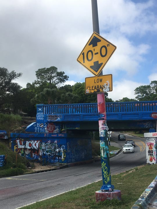A new sign visible to drivers heading north on 17th Avenue displays a lower maximum height warning of 10 feet, a change from the previous sign warning that the clearance was 10 feet, 8 inches. The city hopes the new signs will deter large moving trucks from attempting to drive under the Graffiti Bridge.