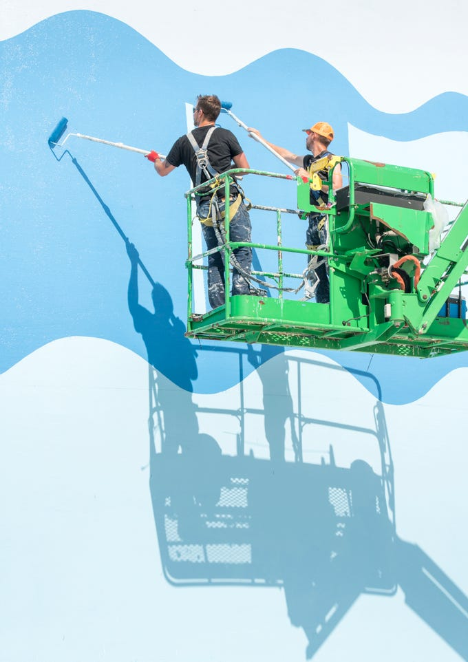 Michael Wiegel, left, and Andy Brend, of Jetco Ltd., paint the newest water tower along Pensacola Beach Blvd. in Pensacola Beach on Thursday, April 11, 2019.