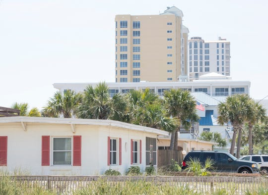 Older cement brick houses sit alongside newer buildings in Pensacola Beach. Escambia County and Pensacola Beach leaders are trying to bring some uniformity to the complicated lease system that has governed development on the beach since 1947.