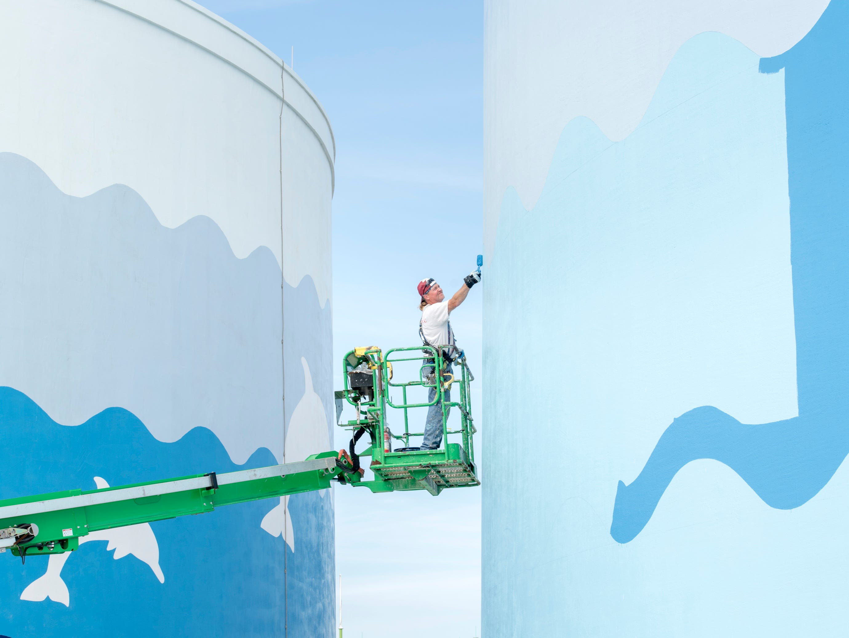 Rob Gaeth, of Jetco Ltd., paints the newest water tower along Pensacola Beach Blvd. in Pensacola Beach on Thursday, April 11, 2019.