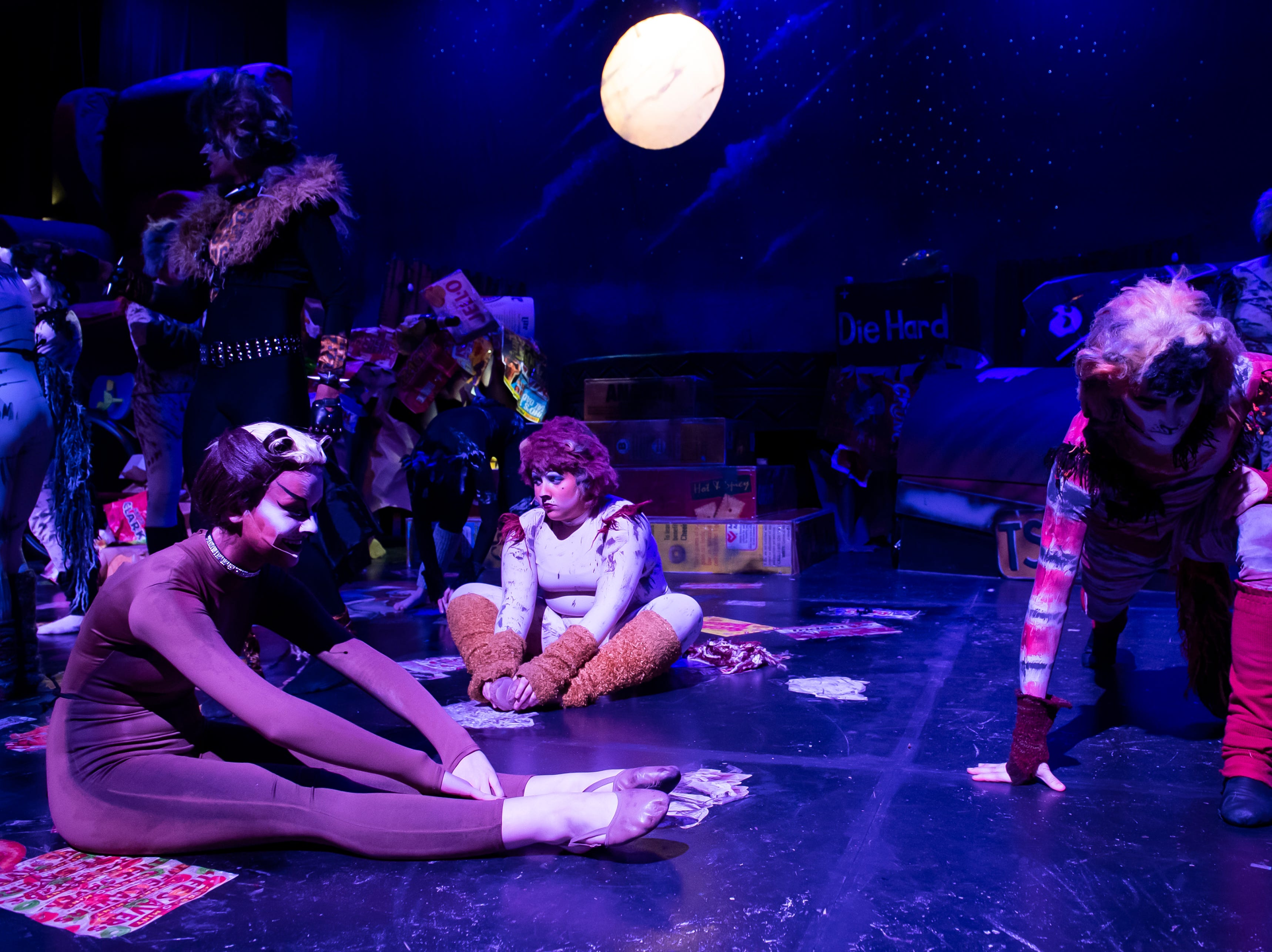 """Hanover High School students stretch before the start of a dress rehearsal for their production of the musical """"Cats"""" on Wednesday, April 10, 2019."""