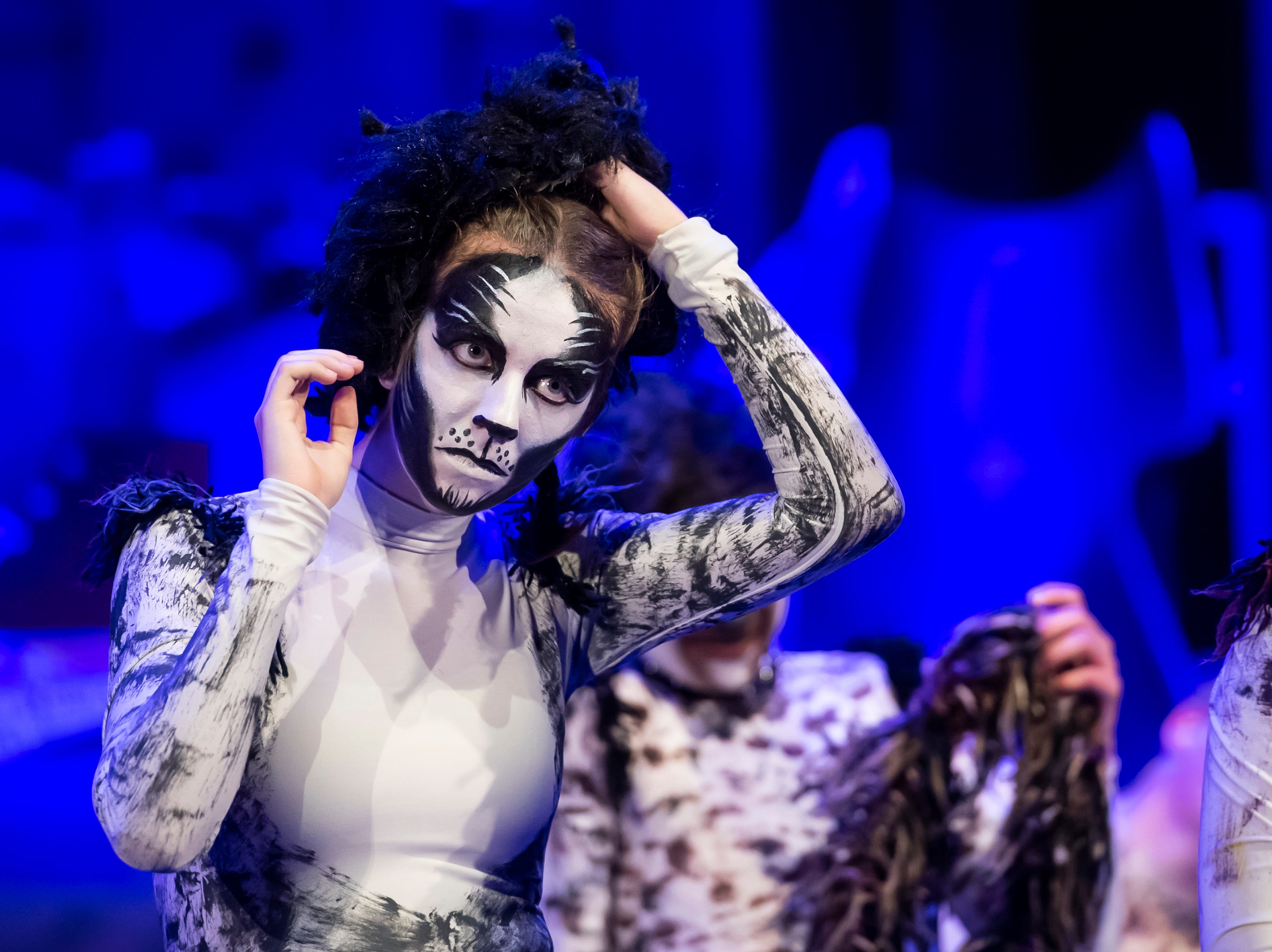 """Hanover High School students listen to feedback after finishing a dress rehearsal for their production of the musical """"Cats"""" on Wednesday, April 10, 2019."""