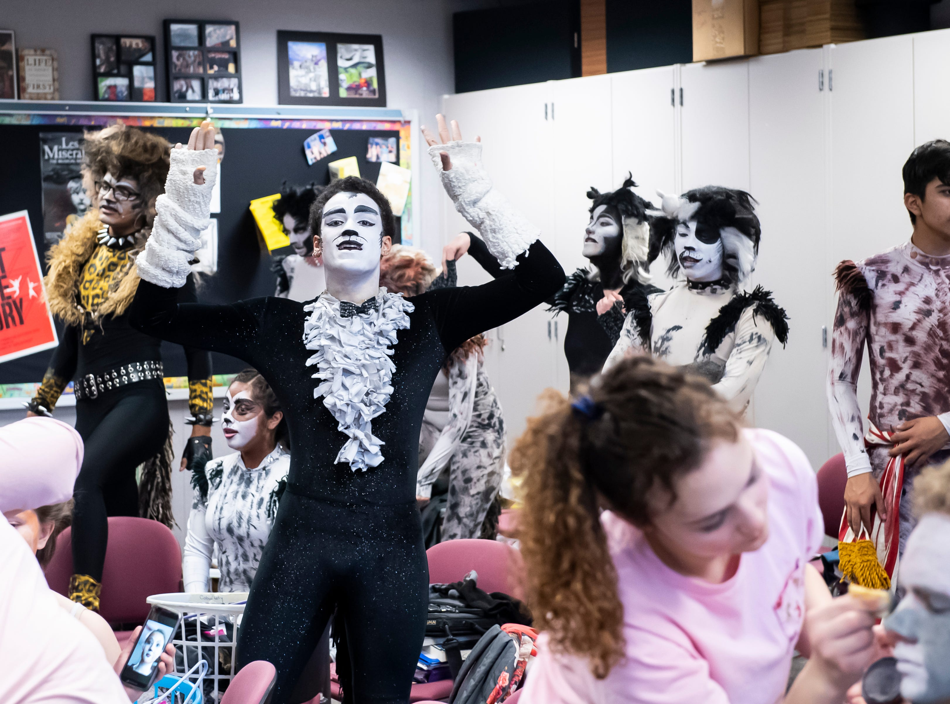 """Malcolm Ellis, center, participates in warmups during a dress rehearsal for Hanover High School's production of """"Cats"""" on Wednesday, April 10, 2019."""