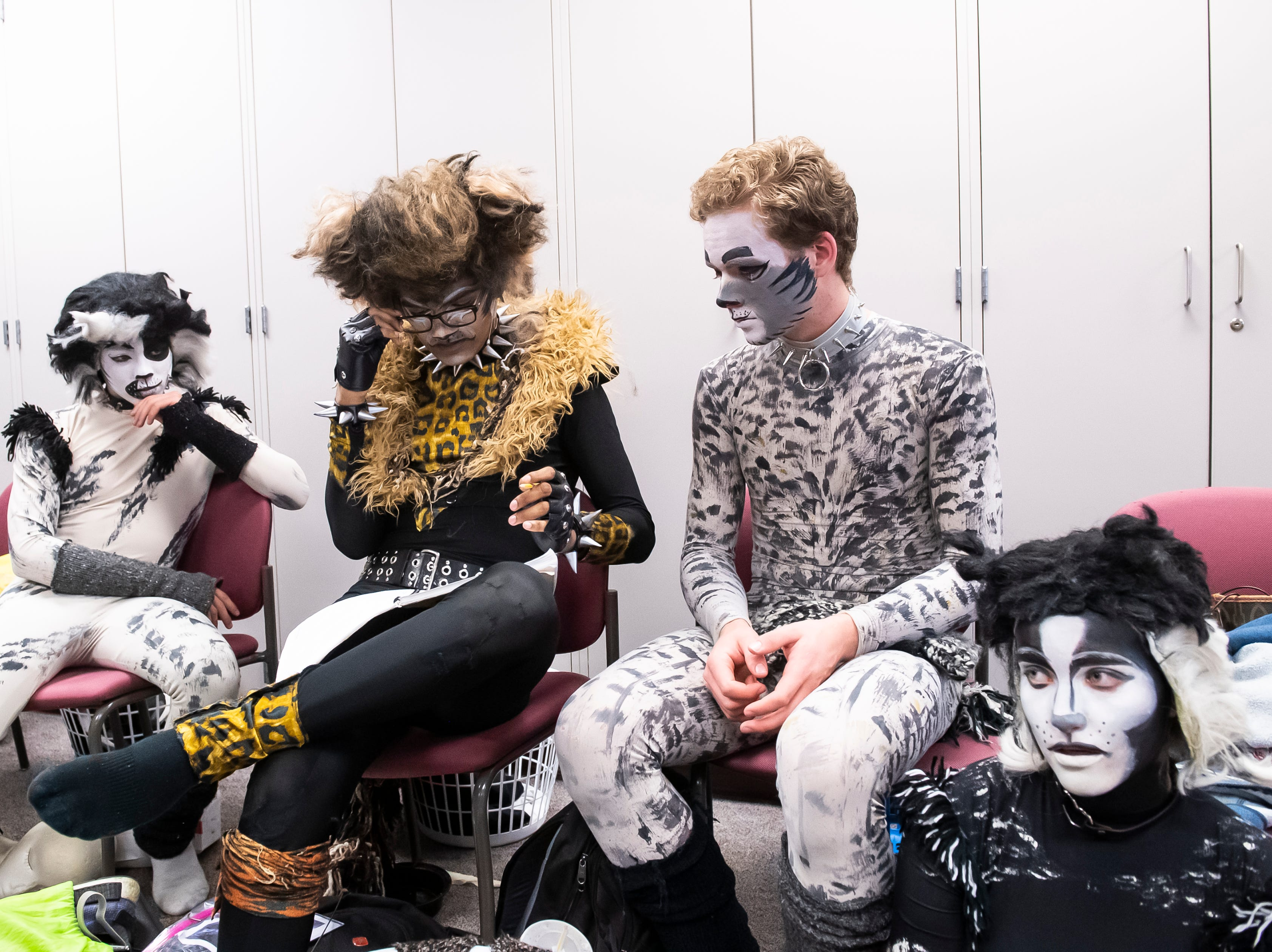 """(From left) Toby Groft, Diego Oropeza, Sodi Krehler and Olivia Keefer wait before the start of a dress rehearsal for Hanover High School's production of """"Cats"""" on Wednesday, April 10, 2019."""