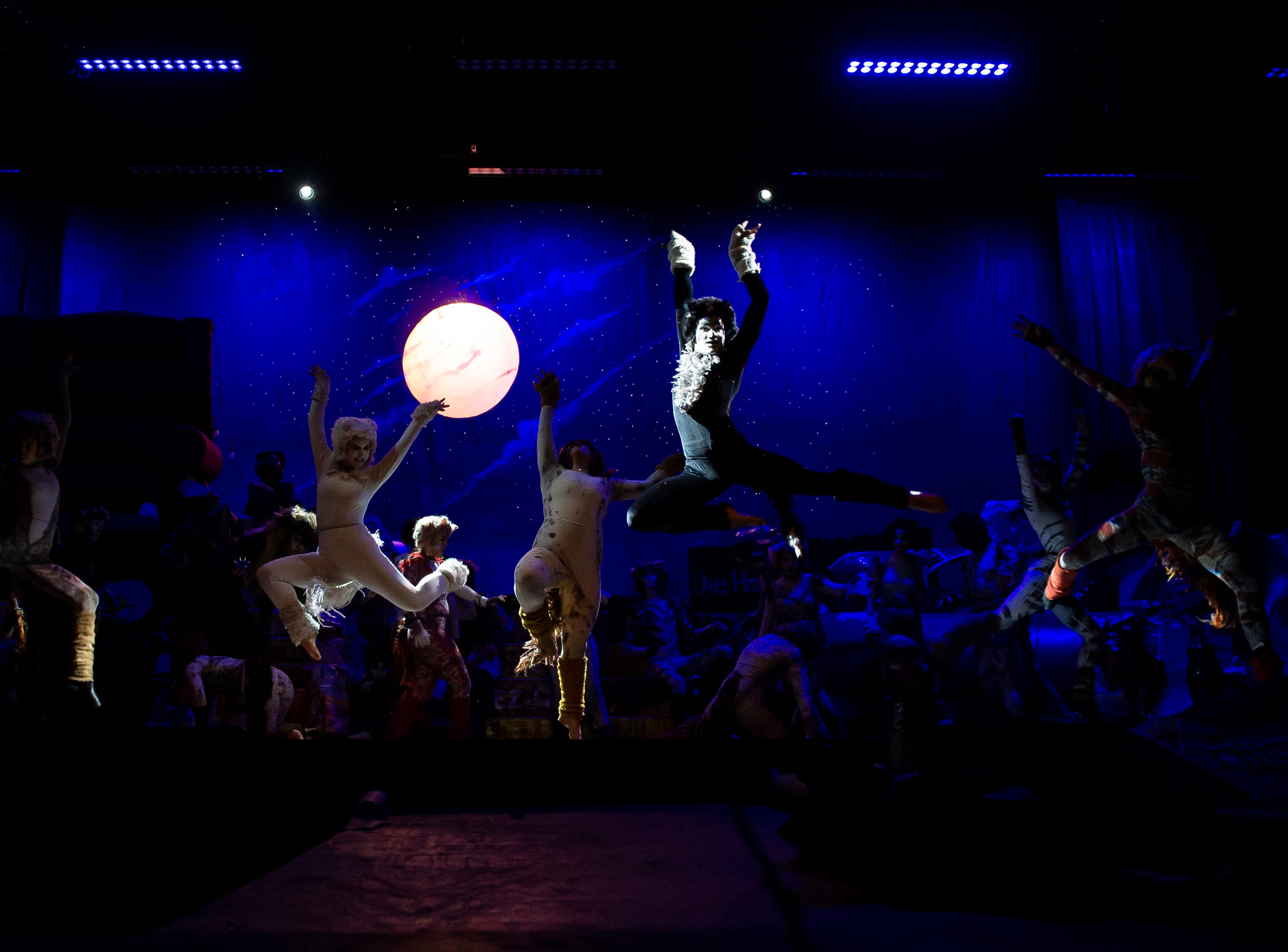 """Hanover High School students perform during a rehearsal for their production of the musical """"Cats"""" on Wednesday, April 10, 2019."""