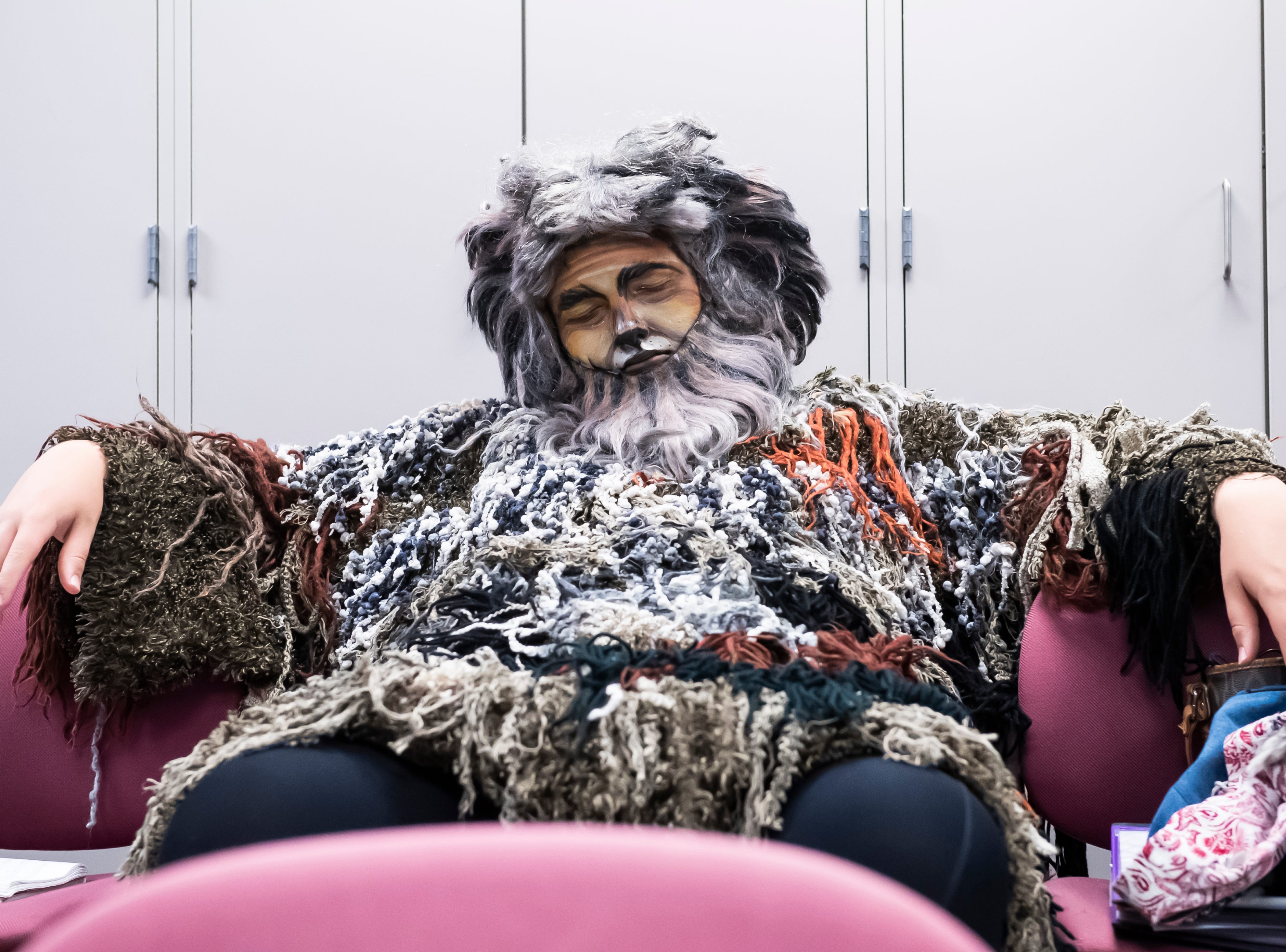 """Ben Newman, who plays the character of Old Deuteronomy, rests his eyes before the start of a dress rehearsal of """"Cats"""" at Hanover High School on Wednesday, April 10, 2019."""